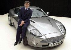 Pierce Brosnan poses in James Bond's famous tuxedo beside an Aston Martin in Picture: PA Aston Martin Vanquish, Aston Martin Rapide, James Bond Cars, James Bond Style, Pierce Brosnan, Glamping, Clint Walker, London Films, British Sports Cars