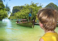 Travel with your children!  Taking a boat in Krabi, Thailand.