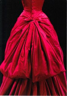 Evening dress by Cristóbal Balenciaga. From Paris about 1955. Photo from a postcard via the Victoria and Albert Museum.