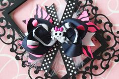 Punk Rock Princess OTT Bow  with Feathers. $8.50, via Etsy.