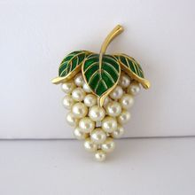 Vintage Trifari Faux Pearl and Green Enamel Grape Cluster Pin /  Made by Trifari in the 1950s, this gold tone pin has white faux pearls that form the shape of a cluster of grapes / 85