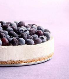 This gorgeous no-bake cheesecake will make everyone at your table want to start with dessert first. And with the temptation of the pretzel-almond crust, creamy vanilla filling, and frozen blueberries on top, who could say no? Chocolate Swirl Cheesecake, No Bake Blueberry Cheesecake, Frozen Cheesecake, Baked Cheesecake Recipe, Classic Cheesecake, Cheesecake Desserts, Frozen Desserts, Frozen Treats, Summer Dessert Recipes