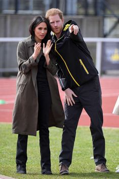 Meghan Markle, Prince Harry are posing for a picture: Meghan Markle and Prince Harry appear at the UK Team Trials for the Invictus Games at Bath University on April 6, 2018.