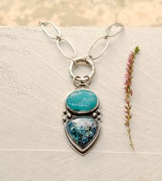 ON SALE! Reduced by 25%! Price is as marked!    Handmade from start to finish, this beautiful ocean blue necklace features striking stones such as an