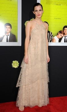 Emma Watson Evening Dress    Emma looked quietly elegant in this tiered nude gown with delicate subtle beading.  Brand: Giorgio Armani