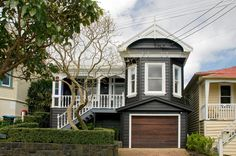 Lovely Kiwi villa, painted black with white trim! A totally different experience in style. New Zealand somewhere... Very tidy.