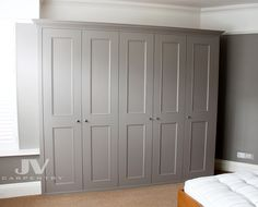 Classic Fitted Wardrobe with beaded shaker doors and cornice This fitted wardrobe has been installed in 2012 and became very popular choice. It's made with shoe racks and drawers and hand painted in grey colour. Made and hand painted by JV carpentry team in Hanwell, West London Fitted wardrobe with coving Fitted … Continued