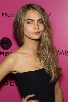 Cara Delevingne shows off the décolletage.
