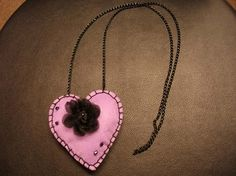 Felt pendant with organza rose.