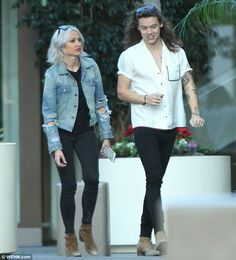 Chilled vibes: Harry Styles enjoyed a leisurely day out with hairdresser and close friend Lou Teasdale in Los Angeles, California on Tuesday