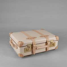 The Safari Series celebrates the timeless elegance of the distinguished suitcases made by Globe-Trotter in the late 1920s. Available in the classic colour options of Ivory and Colonial Brown, each item in the collection is beautifully hand finished with Natural leather corners, handles and straps. The nature of this natural leather is to darken with age, developing a rich honey colour over time.