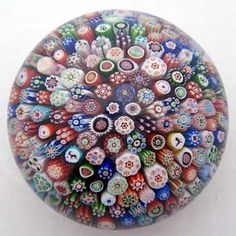 """Antique paperweights can be lovely and used in groupings since they can vary from 2-3"""" diameter to about 5"""" diameter. This antique French Baccarat paperweight is in a millefiori (""""1000 flowers"""") design. Many countries made them, and they can be very valuable as well as decorative."""