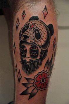 Panda bear head man tattoo