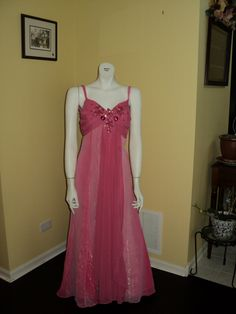 Think pink! This satin and taffeta gown has lots of sparkle for a fun and flirty look.