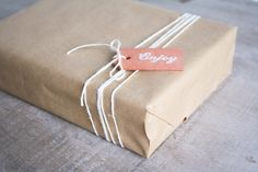 packaging: I love this idea of wrapping the box in brown paper and tying with string. I want to try this with my print packaging.