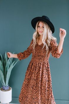We are loving the cooler temps, and this is the PERFECT piece to keep you cozy all season! It's super soft fabric is so comfy and flattering on all body types! The leopard print adds style without. Modest Dresses, Summer Dresses, Disney Dapper Day, Smocking Patterns, Dress Stand, Boutique Design, Animal Print Dresses, Smock Dress, Fashion Outfits