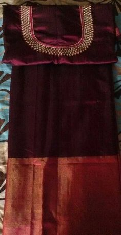 What a colour.....wine red silk saree