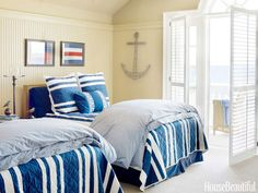 In a guest bedroom, vintage nautical flags inspired the choice of striped bed linens from Pottery Barn. Design: Martin Horner of Soucie Horner.
