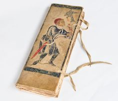 A 17th-century Swiss account book with applied decoration of a medieval man hawking
