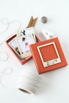 Make polaroid wooden frames and slot photos into them.