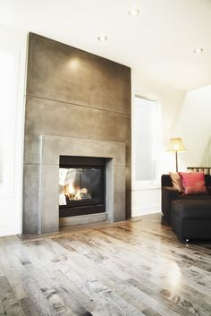 Concrete fireplaces are my FAV!! This one is by Sculptural Design Inc.