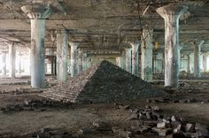 """Building Monuments Amid Detroit's Modern Day Ruins - Scott Hocking's """"Ziggurat"""" was assembled from found blocks inside the Fisher Body Plant, over the course of 8 months. Monuments, Abandoned Detroit, Abandoned Places, Bokashi, Outsider Art, Outdoor Art, Recycled Art, Public Art, Urban Art"""