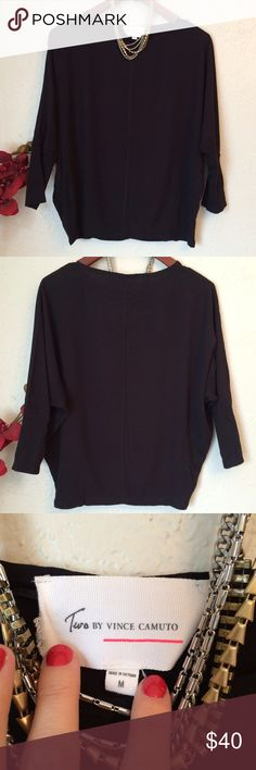"""Vince Camuto Dolman Top Beautiful, silky smooth Vince Camuto top in a dolman style w/ribbed material panels along sides. Boatneck neckline, seam down middle in front& back, 3/4 sleeves, EUC, no notable flaws. This top keeps you comfortable while still looking chic. Sz Med, 24"""" long& Approx chest measurement is 26"""" but w/the dolman style, it's very generous across that area. Two by Vince Camuto Tops"""