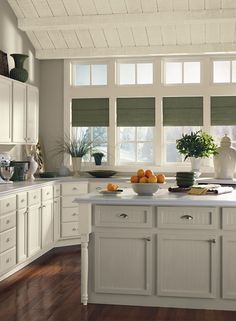 Versatile Gray Kitchen.  Walls and island cabinet are Thunder (AF-685), ceiling, trim and cabinets are Cream Silk (2146-60) and accents are Jojoba (AF-460).  All paint by Benjamin Moore.