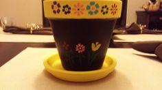 Stenciled terracotta flower pot.