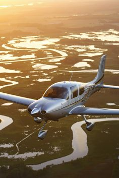 The Cirrus SR22 is a single-engine, four-seat, composite aircraft, built by Cirrus Aircraft starting in 2001. It is a more powerful version of the Cirrus SR20, with a larger wing, higher fuel capacity, and a 310 horsepower engine.