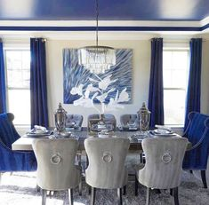 Sapphire's intense, inky beauty makes it a standout in dining room. Complementary dove grey Charlotte chairs and a glam chandelier add luxurious intrigue. Tap the link in our bio to shop every piece from this dining room! Round Dinning Room Table, Dining Room Blue, Dining Room Table Decor, Luxury Dining Room, Elegant Dining Room, Dining Room Design, Living Room Decor, Dining Rooms, Dining Chairs