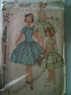 #Simplicity1557. Girls' dress and mock collar, size 10. Looks to be from the 1950's.