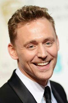 Tom Hiddleston and that glorious smile!!