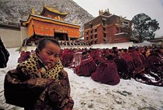 There is a lama under the canopy at the temple entrance giving teachings and look at all the monks in the snow receiving teachings. When you want dharma bad enough, nothing can stop you. Tsem Rinpoche