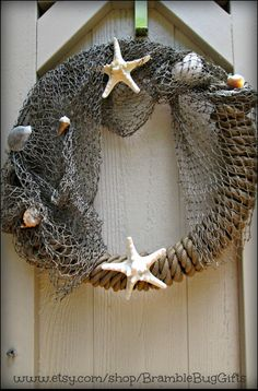 Feel like youre on vacation in your own home! This nautical wreath features beautiful sea shells and star fish paired with rustic, boating style