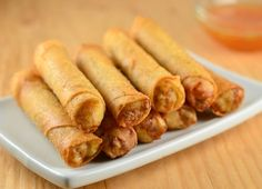 Lumpiang shanghai are Filipino-style springrolls filled with ground meat, carrots, green onions, water chestnuts and garlic
