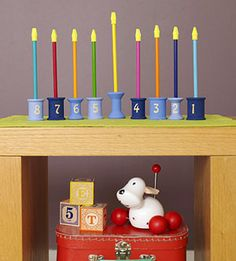 "Cool Hanukkah Menorah Craft - Your child will love making a menorah he can ""light"" each night."
