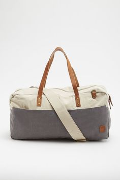 eeef405a9f7 Carry your essentials in style with the Two Tone Washed Canvas Shoulder Duffle  Bag. Made from durable canvas, its leather trimming and duotone style make  it ...