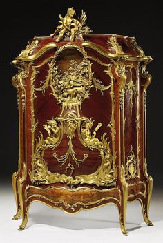 'BAHUT MARINE': A HIGHLY IMPORTANT FRENCH ORMOLU-MOUNTED KINGWOOD, SATINE, MAHOGANY AND MARQUETRY CABINET<br />BY FRANÇOIS LINKE, INDEX NUMBER 560, THE MOUNTS DESIGNED BY LÉON MESSAGÉ, PARIS, 1899-1904<br />Of <i>bombé</i>