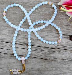 8mm Beautiful, softly opalescent, man-made Opalite mala with Lapis and silver markers. This Opalite is also sometimes called Sea Opal.