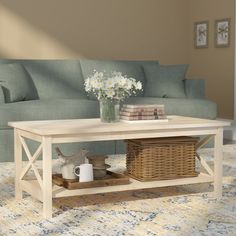Arrange a piped cotton Lawson sofa on one side of the table, and a flat screen-topped weathered wood television stand on the other, then place a pewter tray on this design to corral remotes and Coffee Tables For Sale, Solid Wood Coffee Table, Coffee Table Rectangle, Cool Coffee Tables, Coffee Table With Storage, Coffee Table Design, Country Coffee Table, Affordable Home Decor, Cheap Home Decor