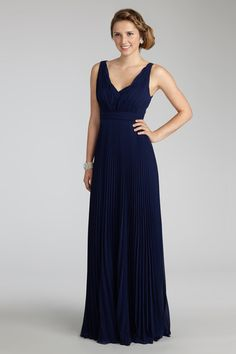 The flattering deep v-neckline on this floor sweeping pleated gown radiates pure elegance. Giselle in midnight by Donna Morgan.