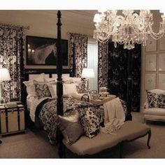Love the black, tan and cream colors in this gorgeous bedroom...and the chandelier too!