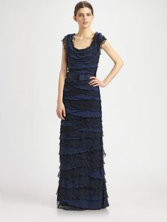 Like this for Isra's formal outfit, but would need a jacket of some sort to keep with the aesthetic I'm going for. (Tadashi Shoji Ruffle Gown)