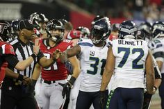 Kam Chancellor Photos Photos - Kam Chancellor #31 of the Seattle Seahawks reacts after a play against the Atlanta Falcons at the Georgia Dome on January 14, 2017 in Atlanta, Georgia. - Divisional Round - Seattle Seahawks v Atlanta Falcons