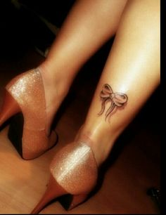 Bow tattoo on ankle