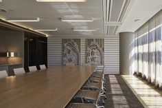 HASSELL - Formal meeting rooms feature artwork and honey-gold tones.