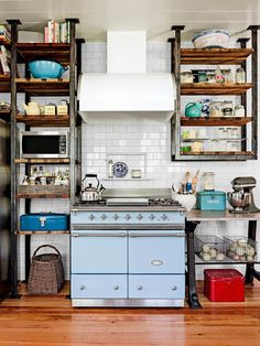 This kitchen uses open shelves instead of cabinets for easy access and an eclectic vibe #hgtvmagazine http://www.hgtv.com/kitchens/one-of-a-kind-kitchen-design/pictures/page-2.html?soc=pinterest