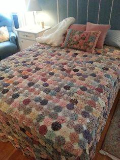 A bedspread made of cloth yoyos
