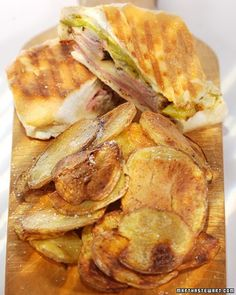 Cuban Sandwiches - Citrus-marinated roast pork loin, Black Forest ham, Swiss cheese, and dill pickle slices fill these grilled sandwiches. Serve them with spicy mustard and plantain chips on the side.